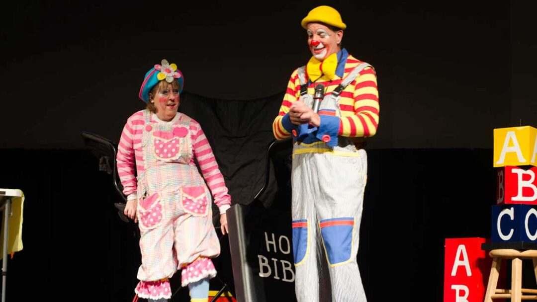 Two clowns performing on stage