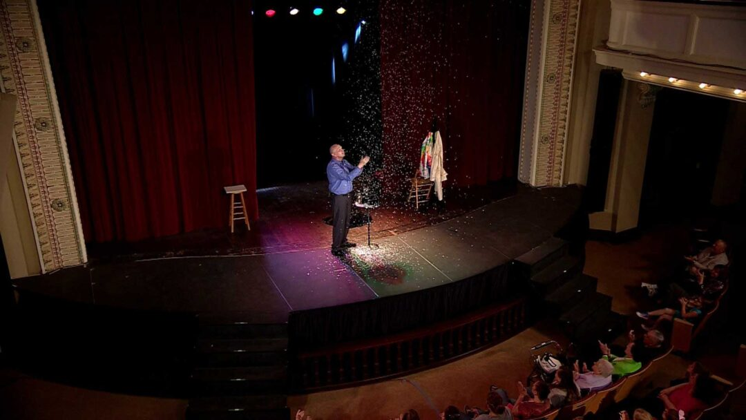 Magician performing on stage
